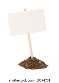 Blank white sign in mount of dirt isolated on a white background.