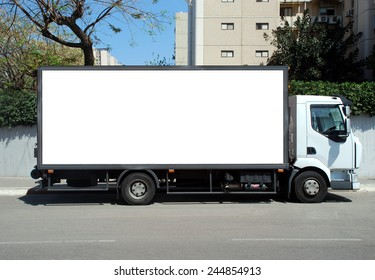 Blank white sign on an-unmarked truck