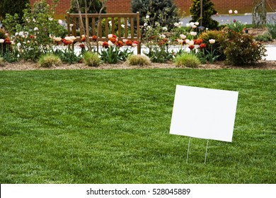 Blank white sign on newly cut grass. Copy space. Horizontal.
