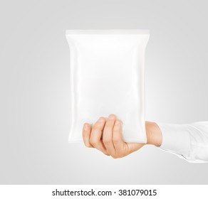 Blank white snack bag mock up hold in hand isolated. Clear white chips pack mockup. Cookie, candy, sugar, cracker, nuts, supermarket foil frozen plastic container ready for logo design presentation.