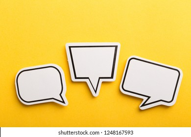 Blank white speech bubble isolated on yellow background.