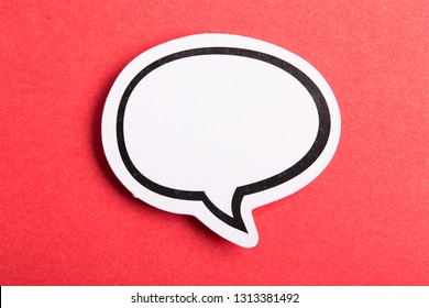 Blank white speech bubble isolated on red background.