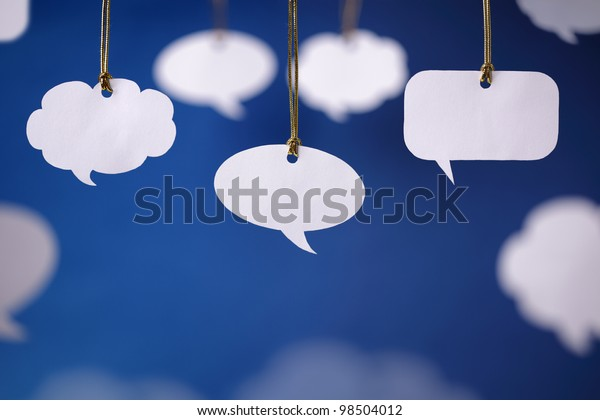 Blank white speech bubbles hanging from a cord