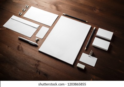 Blank white stationery set. Business brand template on wooden background.