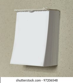"""blank white """"tear off"""" calendar with room for your text on a cardboard background"""