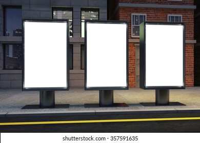 Blank white three billboards on empty street at night, mock up