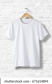 Blank White T-Shirt Mock-up hanging on white wall, front side view. Ready to replace your design