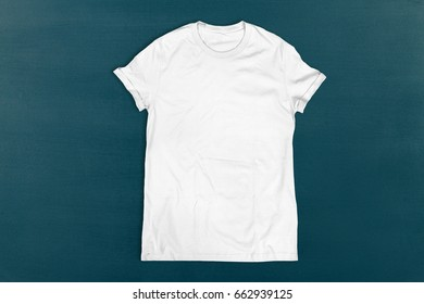 Blank white t-shirt on chalkboard background or texture