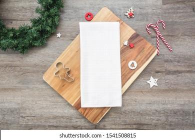 Blank white waffle weave tea towel on dark wood backround with christmas decoration, kitchen towel christmas mockup