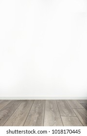 Blank white wall and gray wooden floor