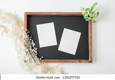 Blank white wedding vow books on chalk board, mock up