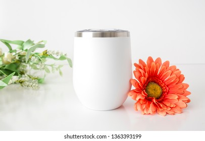 Blank white wine tumbler with flower decor, summer drinkware mock up