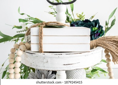 Blank white wooden book stack on tier tray with rustic props, farmhouse style decoration mockup - Shutterstock ID 1879245415