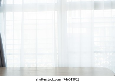 blank wood office table with white curtain texture background.