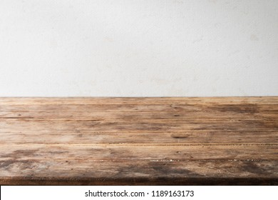 Blank wood table desk old vintage grunge design shelf perspective with blurry background normal.