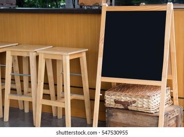 Blank wooden black chalkboard menu in coffee shop