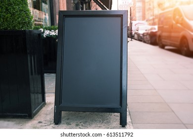 blank wooden blackboard sidewalk restaurants advertising street