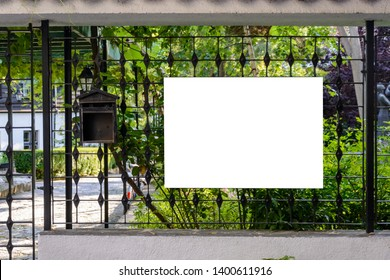 blank wooden board on a fence , place for text .