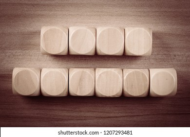 Blank wooden cube blocks on the table.