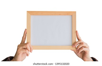 Blank wooden photo Frame in the woman's hand isolated on white background .Blank space for text and images of file with Clipping Path .
