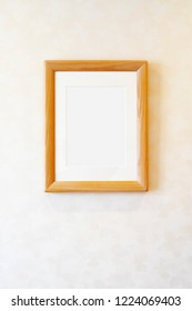 Blank wooden picture frame on the wall, rectangular photo frame with shadow