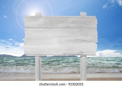 blank  wooden  sign on beach