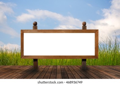 Blank wooden sign on a wooden floor with natural backdrop , 3D rendering