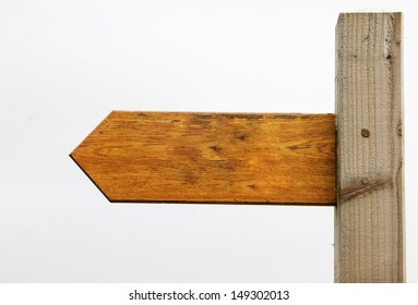 A blank wooden sign pointing left