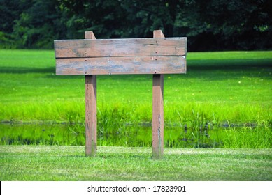 A blank wooden sign ready for your text