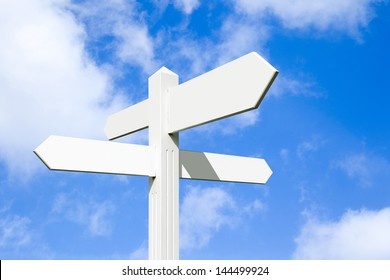 Blank wooden signpost with four arrows over blue sky - just add your text.