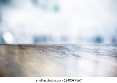 BLANK WOODEN TABLE DESK TOP ON COLD LIGHT WINTER BACKGROUND, BACKDROP FOR FOOD AND DRINKS