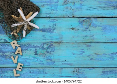 Blank wooden teal blue rustic  sign with fish netting and seashells border