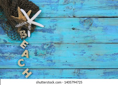 Blank wooden teal blue rustic beach sign with fish netting and seashells border