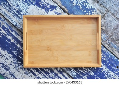 Blank wooden tray on wood background.