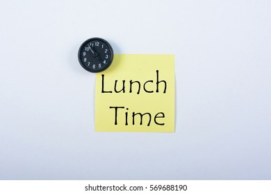 Blank yellow notepad with black magnetic watch isolated on white background. Lunch Time