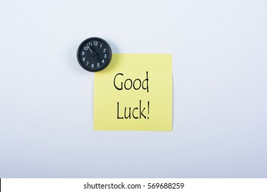 Blank yellow notepad with black magnetic watch isolated on white background. Good Luck!