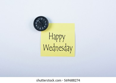 Blank yellow notepad with black magnetic watch isolated on white background. Happy Wednesday