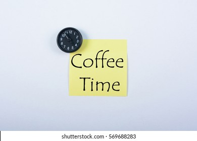 Blank yellow notepad with black magnetic watch isolated on white background. Coffee Time