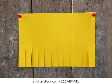 Blank yellow paper with tear off tabs