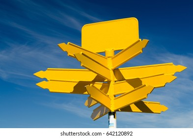 Blank yellow road sign on a blue sky background