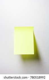 Blank Yellow Sticky Note isolated on white background