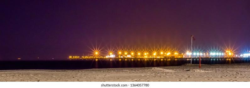 Blankenberge beach at night, Belgian coastline, colorful lights creating beautiful stars, popular travel location in Belgium