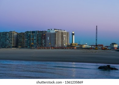 Blankenberge beach, view on the city with lighted lighthouse, popular belgian city architecture by night