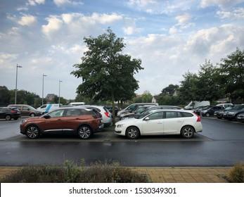 Blankenberge, Belgium - 13 October 2019: general public parking with randomly parked cars of european brands