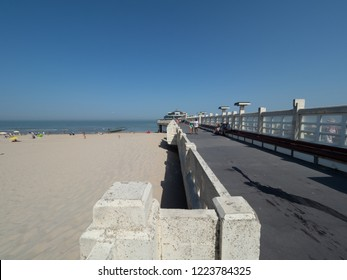 Blankenberge, Belgium - 7 August 2018: Wide angle image of the pier near the beach of Blankenberge.