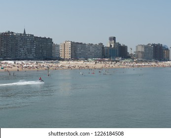 Blankenberge, Belgium - 7 August 2018: A lifeguard patrols with a jet ski on the crowded beach of Blankenberge.