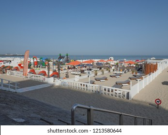 Blankenberge, Belgium - August 7, 2018: Image of the dike of Blankenberge, with its many cafes and restaurants, playgrounds on the beach.