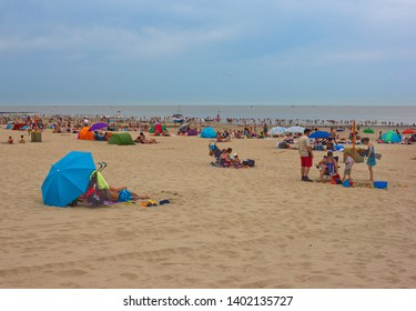 Blankenberge, Belgium - July 19, 2014: North sea beach with sunbathing people