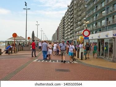 Blankenberge, Belgium - July 19, 2014: Summer Beach Promenade with crowds of people