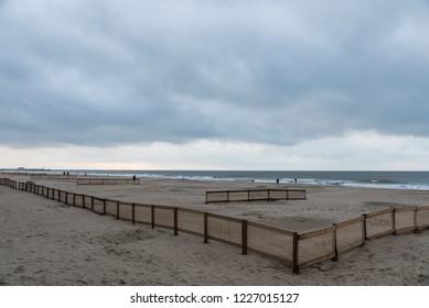 Blankenberge, Flanders / Belgium - 10 30 2018: Large empty sandy beach at the Belgian North sea during ebb tide in autumn.